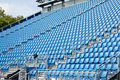Tribune seats folded blue plastic chairs on a temporary Royalty Free Stock Images