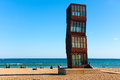 Tribute to barceloneta in barcelona spain – november tourists relaxing at beach platja de sant sebastia and sculpture by rebecca Royalty Free Stock Photos