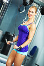 Triceps workout image of fitness woman in gym working out Royalty Free Stock Image