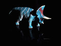 Triceratops dinosaur toy figure against black background with reflection Stock Photo