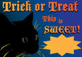 Trick or treat ad starter halloween with black cat and the words this is sweet and a starburst for adding text Stock Photos