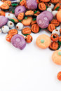 Trick or treat colorful group of halloween candy in shape of pumpkins and skulls with funny smiley faces large space for copy Royalty Free Stock Photos