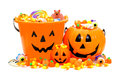 Trick or treat group of halloween jack o lantern candy holders and pile of candies Royalty Free Stock Image