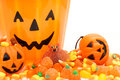 Trick or treat halloween candy and jack o lantern holders close up Royalty Free Stock Images