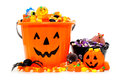 Trick or treat halloween jack o lantern candy bowls with assorted candy over white Royalty Free Stock Images
