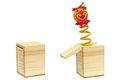 Tricky toy clown spring coming out wooden box Stock Photography