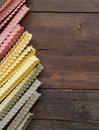 Tricolor mafalde pasta on the wood old wooded table Stock Photography