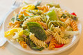 Tricolor pasta salad delightful and vibrant with healthy vegetables Royalty Free Stock Photos