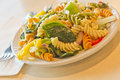 Tricolor pasta salad delightful and vibrant with healthy vegetables Stock Photos