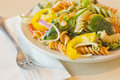 Tricolor pasta salad delightful and vibrant with healthy vegetables Stock Photo