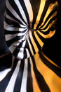 Tricolor spiral bodyart on the body of a young girl look like zebra pattern skin Royalty Free Stock Images