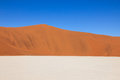stock image of  Tricolored graphical desert with dunes, salt pan, sky. Sossusvlei, Namibia