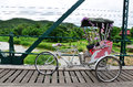 Tricycle thai style on Bridge over Pai River at Pai at Mae Hong Son Thailand Royalty Free Stock Photo