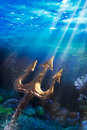 Trident on a dramatic underwater background poseidon s under the sea photo composite Stock Image