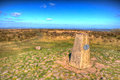 Trig point at Black Down the highest hill in the Mendip Hills Somerset in south-west England UK in colourful HDR Royalty Free Stock Photo