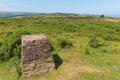 Trig Point on North Hill near Minehead UK with beautiful Somerset countryside Royalty Free Stock Photo