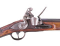 Trigger and lock of flintlock gun isolate. Stock Photography