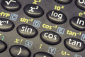 Trigonometry math functions push buttons of scientific calculator with focus on cos button Royalty Free Stock Images