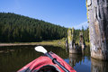 Trillium Lake Landscape with tree trunk in water and kayak Royalty Free Stock Photo