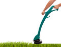 Trimming grass male hands with handheld lawnmower isolated with copy space Royalty Free Stock Image