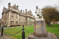 Trinity college dublin ireland april george salmon statue and building at in ireland on april the was founded in as Royalty Free Stock Photo
