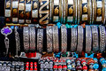 Trinkets and jewelry different colored displayed in the waiting customers Stock Images
