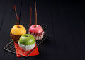 Trio of colorful Halloween apple desserts Royalty Free Stock Photo