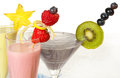 Trio of colorful summer smoothies with decoration Stock Photography