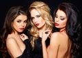 Trio of elegant beautiful coquettish women Royalty Free Stock Photo