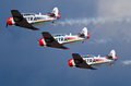 Trio of harvards pretoria south africa may three eqstra harvard trainers in formation with smoke during the time aviation saaf Stock Image