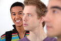 Trio of male students stood in a row Stock Photos