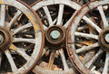 Trio of old wagon cart wheels Royalty Free Stock Image