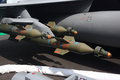 Trio of paveway laser guided bombs three hanging from a pylon a jet fighter taken at the paris air show www paris air show com Stock Image