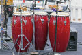 Trio of red conga drums on live concert stage Royalty Free Stock Photos