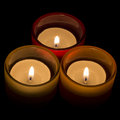 Trio of tea-lights arranged in a triangle Royalty Free Stock Photo