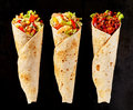 Trio of Tex Mex Fajita Wraps on Black Background Royalty Free Stock Photo