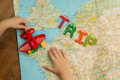 Trip by toy plane around the world with kids. Royalty Free Stock Photo