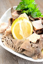 Tripe with lemon entrails of stomach of beef cooked in salted water juice called trippa Stock Photography