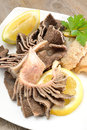 Tripe with lemon entrails of stomach of beef cooked in salted water juice called trippa Stock Photo