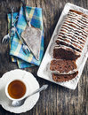 Triple chocolate loaf cake and cup of tea Stock Image