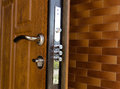 Triple cylinders on a new high security lock installed in wooden front door to home with the locks extended Royalty Free Stock Photography