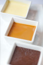 Triple dessert chocolate mousse butterscotch vanilla pudding Stock Photos