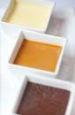 Triple dessert chocolate mousse butterscotch vanilla pudding Stock Photos