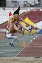 Triple jump athlete female performing during discipline at romanian international atheltics championship stefan cel mare stadium Stock Image