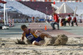 Triple jump athlete male performing during discipline at romanian international atheltics championship stefan cel mare stadium Royalty Free Stock Photos