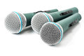 Triple microphone green isolated on white background Stock Images