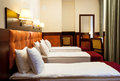 Triple room in hotel interior of a a classic style Royalty Free Stock Image