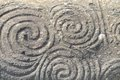 Triple spiral newgrange rock detail with the famous pre celtic at the entrance to unesco heritage ireland Stock Photos
