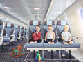 Triplets in the airplane Royalty Free Stock Photo