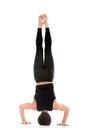 Tripod headstand back view sporty young man working out yoga pilates fitness training doing salamba sirsasana ii Stock Photos